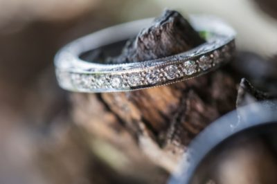 Diamond Eternity ring rests on a piece of wood